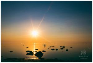 Golden light spilled across still waters